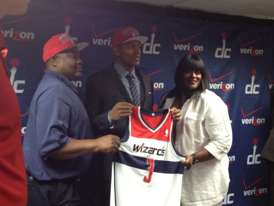 Bradley Beal, the Washington Wizards' No. 3 pick in Thursday's draft, stands for photos with his parents. (Nicolas Nightingale/The Washington Times)