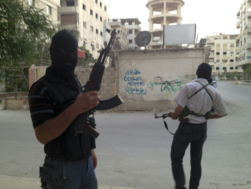 **FILE** Members of the Free Syrian Army are seen June 28, 2012, in a neighborhood of Damascus, Syria. (Associated Press)