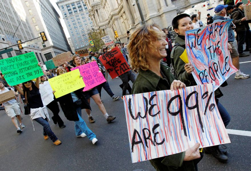 **FILE** Participants in 'Occupy Philadelphia' march Oct. 6, 2011, near City Hall in Philadelphia. (Associated Press)