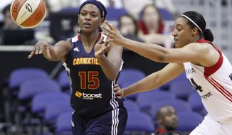 Washington Mystics forward Lindsay Wisdom-Hylton, right, defends Connecticut Sun forward Asjha Jones during the second half of a WNBA game on Friday, June 29, 2012, in Washington. Jones scored 20 points in the 77-64 Sun victory over the Mystics. (AP Photo/Evan Vucci)