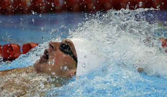 Ryan Lochte swims in the men's 200-meter backstroke preliminaries at the U.S. Olympic trials on Friday, June 29, 2012, in Omaha, Neb. (AP Photo/Mark Humphrey)