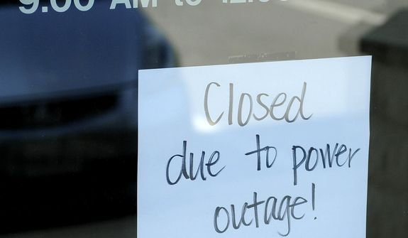 A closed sign is placed on the door at Community Bank on Saturday, June 30, 2012, in Staunton, Va. (AP Photo/The News Leader, Pat Jarrett)