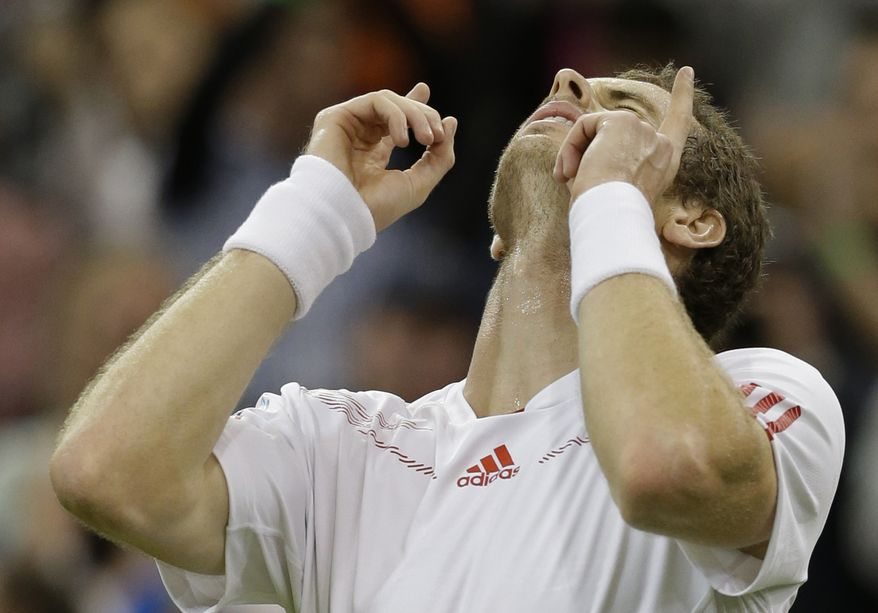 Andy Murray reacts after defeating Marcos Baghdatis during a third-round men's singles match against at the All England Lawn Tennis Championships at Wimbledon, England, on Saturday, June 30, 2012. (AP Photo/Anja Niedringhaus)