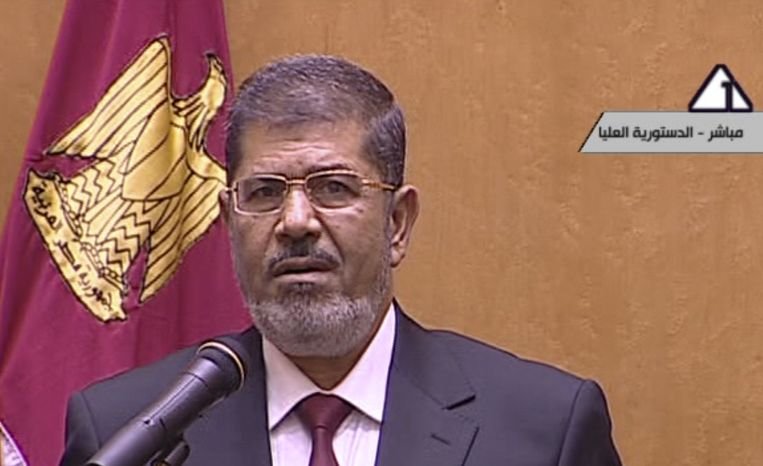 In this image made from Egyptian State Television, Egyptian President Mohammed Morsi makes remarks after he was sworn in at the Supreme Constitutional Court in Cairo, Egypt, Saturday, June 30, 2012. Islamist Mohammed Morsi has been sworn in before Egypt's highest court as the country's first freely elected president, succeeding Hosni Mubarak who was ousted 16 months ago. (AP Photo/Egyptian State TV)