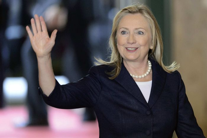 U.S. Secretary of State Hillary Rodham Clinton waves as she arrives for a meeting of the Action Group for Syria at the European headquarters of the United Nations, in Geneva, Switzerland, Saturday, June 30, 2012. (AP Photo/Keystone, Laurent Gillieron)