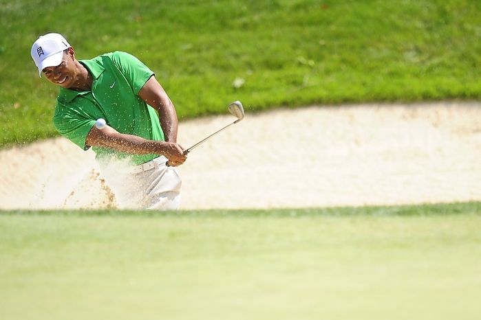 Tiger Woods hits from a bunker on the second hole at Congressional Country Club during third round play of the AT&T National golf tournament, Bethesda, Md., Saturday, June 30, 2012.  (Ryan M.L. Young/The Washington Times)