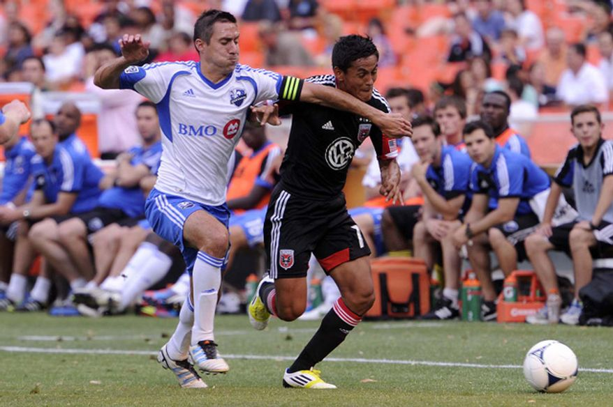 D.C. United's Andy Najar (R) fights through Montreal's Davy Arnaud for the first half ball at RFK Stadium in Washington, D.C., on Saturday, June 30, 2012. (Preston Keres/Special to The Washington Times)