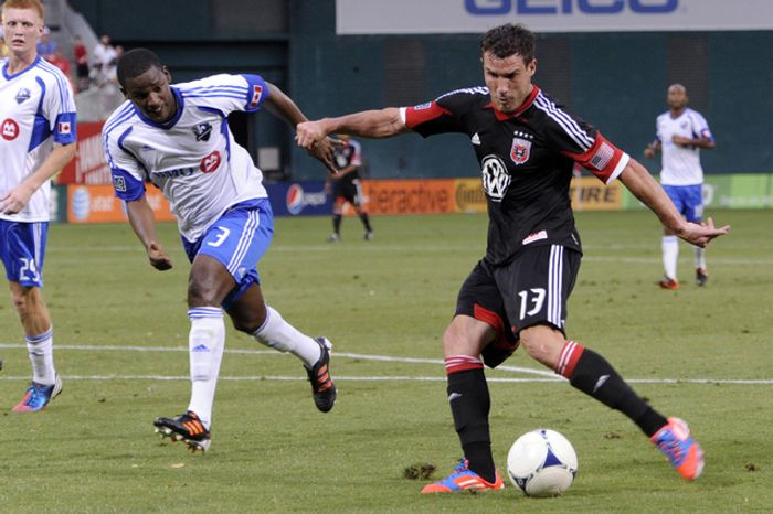 D.C. United's Chris Pontius (13) lines up a goal against Montreal's Shavar Thomas (3) for the first goal of the night at RFK Stadium in Washington, D.C., on Saturday, June 30, 2012. (Preston Keres/Special to The Washington Times)