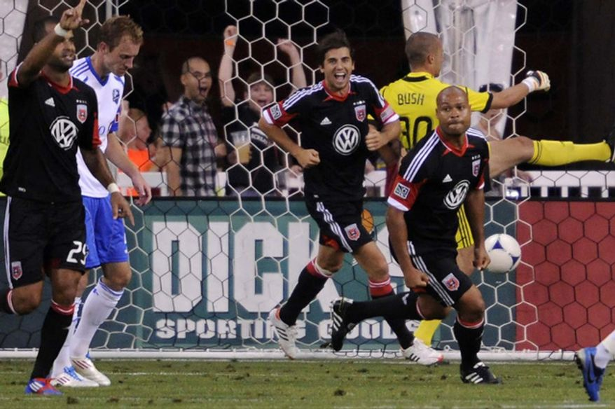 D.C. United's Robbie Russell (R) turns upfield after scoring against Montreal keeper Evan bush in the second half at RFK Stadium in Washington, D.C., on Saturday, June 30, 2012. (Preston Keres/Special to The Washington Times)