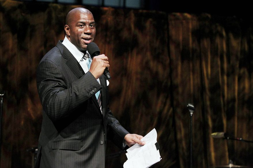 Magic Johnson's latest business venture is Aspire, a television network that went live last week in New York and promises family programming options for black audiences. (Associated Press)