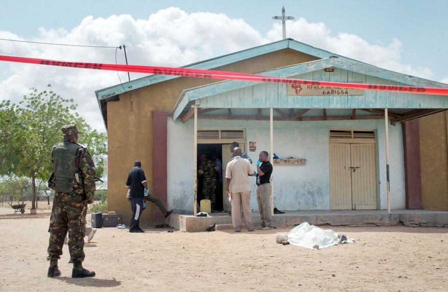Members of the Kenyan security forces inspect the scene, as a body lies covered by a sheet, outside the African Inland Church in Garissa, Kenya, on Sunday. Gunmen killed two policemen guarding a church, snatched their rifles and then opened fire on the congregation. (Associated Press)