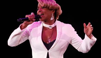 Singer Mary J. Blige sings after the Giorgio Armani fashion show held in Beijing, China, Thursday, May 31, 2012. (AP Photo / Ng Han Guan)