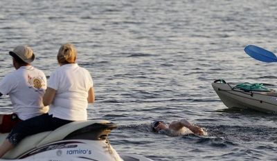 British-Australian endurance swimmer Penny Palfrey begins her bid in Havana to complete a record swim from Cuba to Florida on Friday, June 29, 2012. (AP Photo/Franklin Reyes)