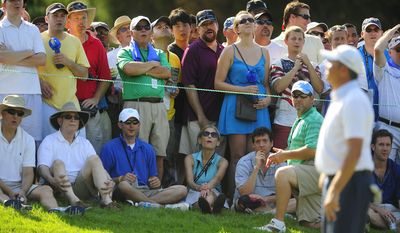 Fans react as Bo Van Pelt misses a birdie putt on the fourteenth hole at Congressional Country Club during final round play of the AT&T National golf tournament, Bethesda, Md., Sunday, July 1, 2012.  (Ryan M.L. Young/The Washington Times)