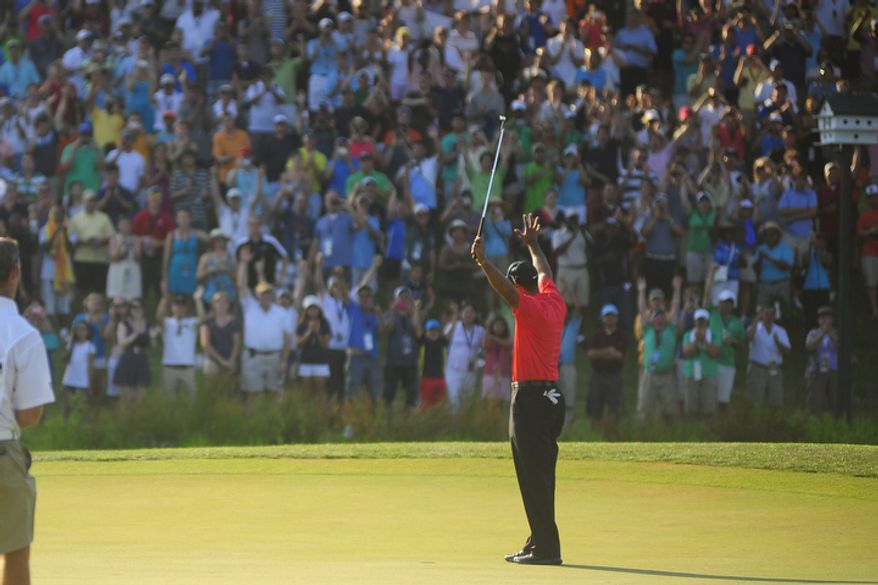 Tiger Woods raises his hands in celebration after capturing victory at Congressional Country Club during final round play of the AT&T National golf tournament, Bethesda, Md., Sunday, July 1, 2012.  (Ryan M.L. Young/The Washington Times)