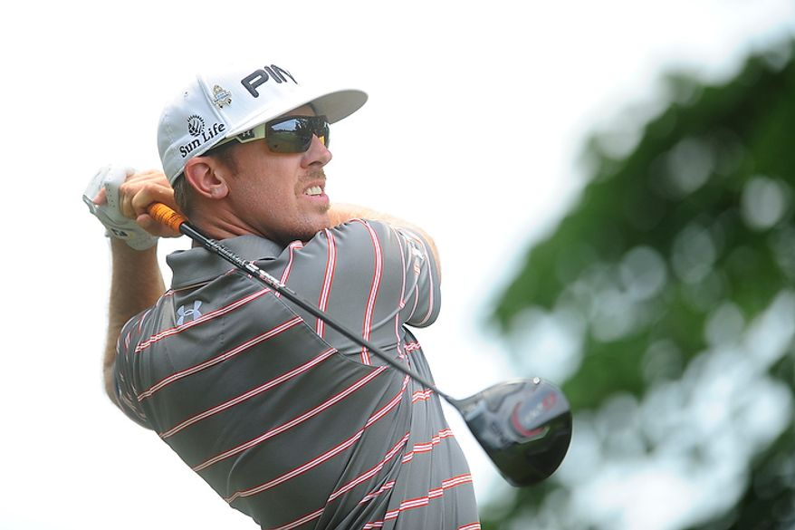Hunter Mahan tees off on the first hole at Congressional Country Club during final round play of the AT&T National golf tournament, Bethesda, Md., Sunday, July 1, 2012.  (Ryan M.L. Young/The Washington Times)
