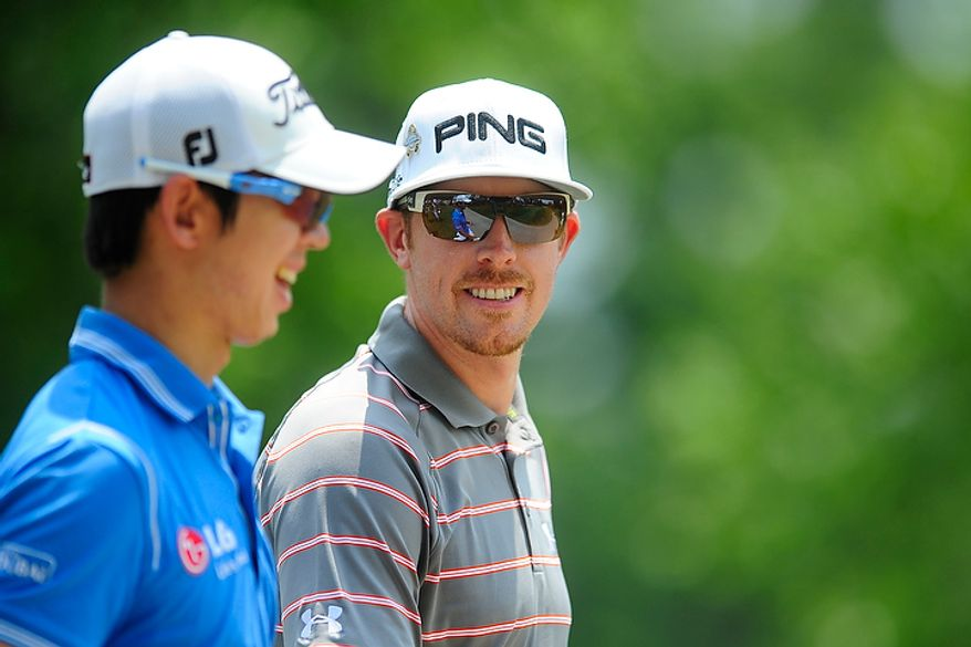 Hunter Mahan, right, and Seung-Yul Noh share a laugh as they walk down the fourth fairway at Congressional Country Club during final round play of the AT&T National golf tournament, Bethesda, Md., Sunday, July 1, 2012.  (Ryan M.L. Young/The Washington Times)