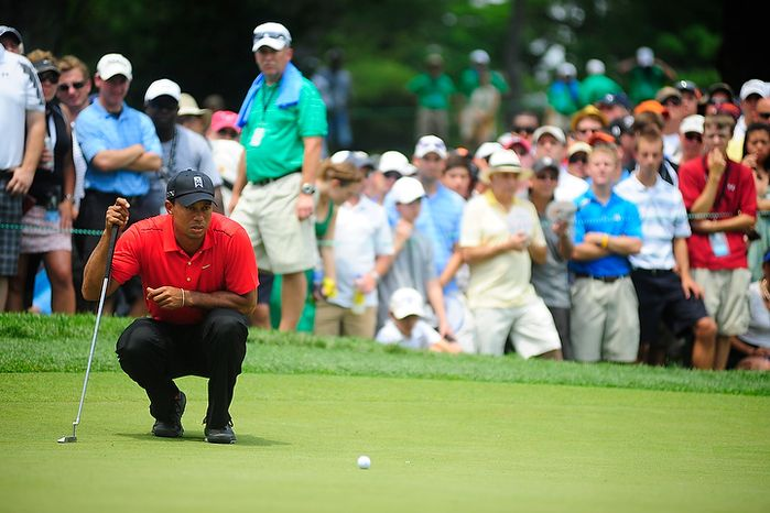 Tiger Woods lines up a putt on the fourth hole at Congressional Country Club during final round play of the AT&T National golf tournament, Bethesda, Md., Sunday, July 1, 2012.  (Ryan M.L. Young/The Washington Times)