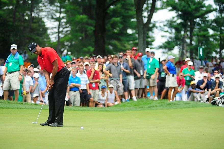 Tiger Woods putts on the fourth green at Congressional Country Club during final round play of the AT&T National golf tournament, Bethesda, Md., Sunday, July 1, 2012.  (Ryan M.L. Young/The Washington Times)