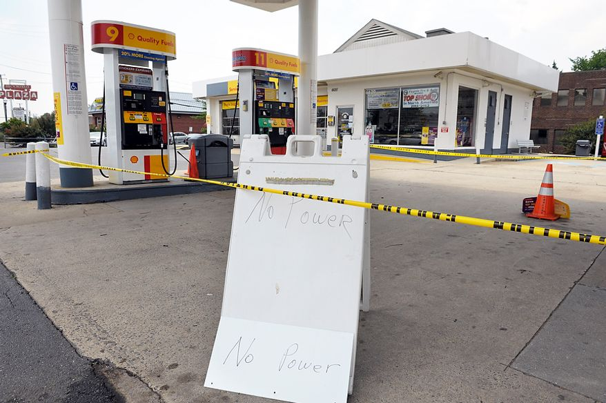 "A gas station, unable to pump gasoline because they have no electricity, displays a sign reading ""No Power""  in Springfield, Va., Sunday, July 1, 2012. A severe storm late Friday knocked out power to approximately one million residents, traffic signals and businesses in the  region.  (AP Photo/Cliff Owen)"