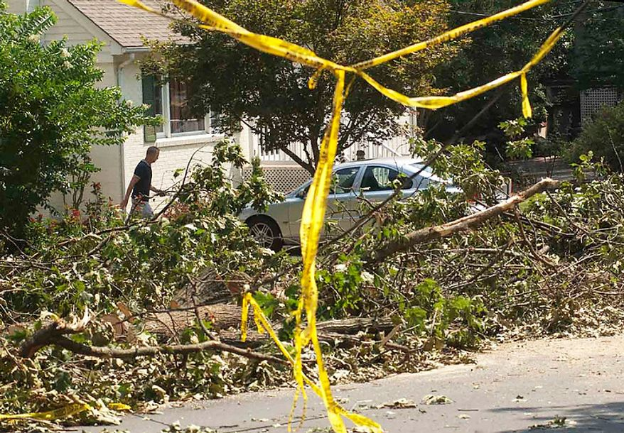 Many trees and power-lines still litter the roadways after last Friday's severe storms on Sunday, July 1, 2012, in Falls Church, Va. Thousand of homes are still without power. (Raymond Thompson/The Washington Times)