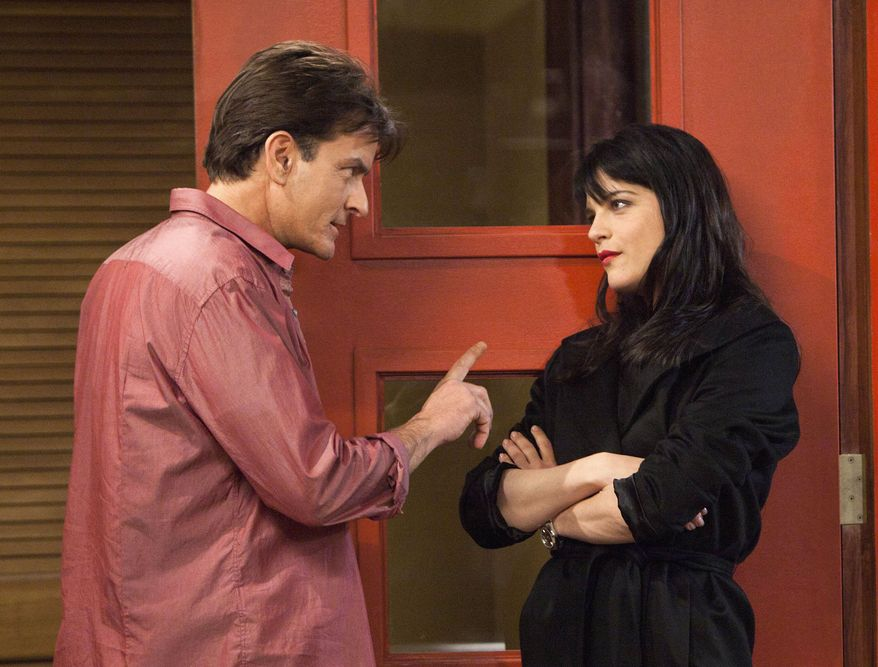 "** FILE ** This publicity image provided by FX shows Charlie Sheen as Charlie Goodson and Selma Blair as Kate Wales in a scene from the new comedy ""Anger Management."" FX network says Thursday's debut of his sitcom, ""Anger Management,"" was the most-watched series premiere in that network's history, drawing 5.5 million viewers. (AP Photo/FX, Adam Rose)"