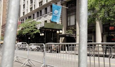 The New York City Police Department erected pens in anticipation of picketers outside the headquarters of Con Edison in New York on Sunday after contract talks broke down. (Associated Press)