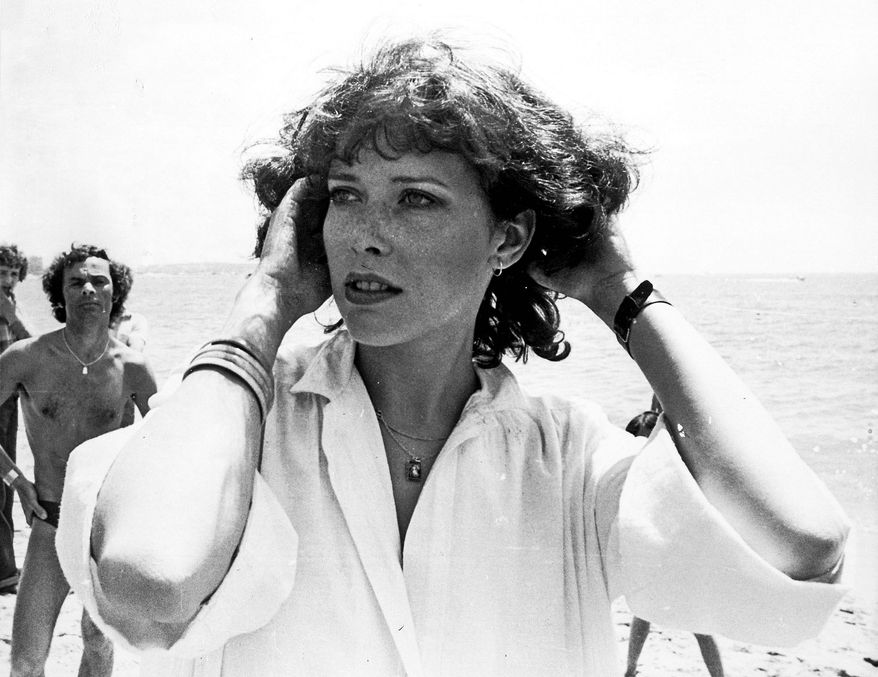 "Dutch actress Sylvia Kristel, who played the role of ""Emmanuelle"", poses for the camera when she arrived at the Cannes Fim Festival, Cannes, May 22, 1975. (AP Photo)"