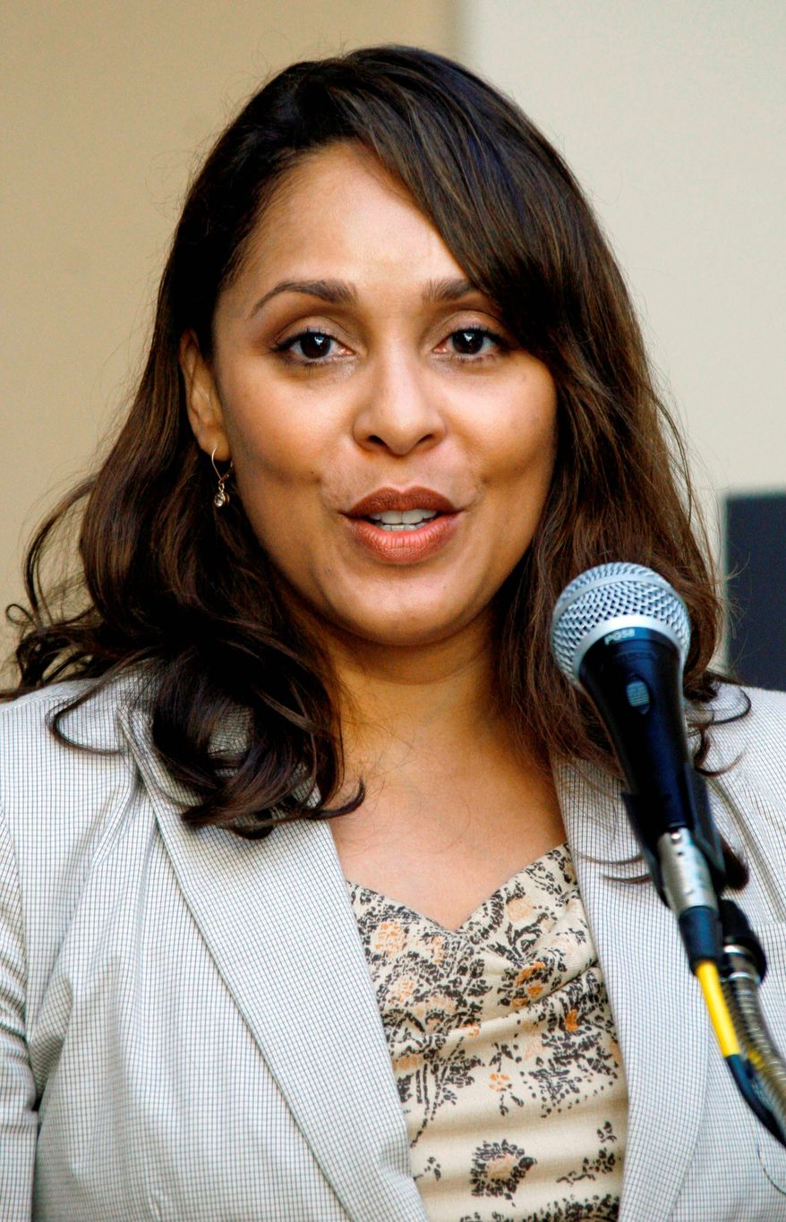 FILE - This Oct. 10, 2007 file photo shows Pulitzer Prize winning author Natasha Trethewey recites a poem at Delta State University in Cleveland, Miss. Trethewey, the nation's new poet laureate, is working on a memoir, currently untitled, that has been acquired by Ecco. The publisher, an imprint of HarperCollins, announced Monday, July 2, 2012, that the book is scheduled to come out in 2014. (AP Photo/Rogelio V. Solis, file)