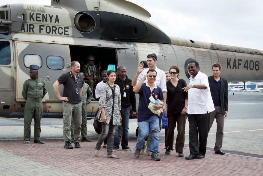"""ASSOCIATED PRESS Four aid workers arrive by Kenyan military helicopter in Nairobi, Kenya, on Monday, three days after they were kidnapped by gunmen who attacked a convoy from a Kenyan refugee camp. """"We are happy. We are back. We are alive and we are happy this has ended,"""" said Qurat-Ul-Ain Sadazai, one of the four workers with the Norwegian Refugee Council. They were rescued by a pro-government Somali militia group."""