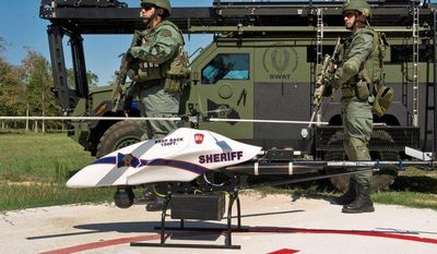 ASSOCIATED PRESS Montgomery County, Texas, SWAT team members are seen with a ShadowHawk drone from Vanguard Defense Industries. With drones becoming available for commercial use in 2015, the industry has devised voluntary standards to protect safety and privacy.