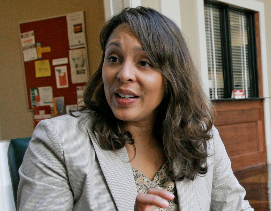 ** FILE ** This Oct. 10, 2007 photo shows Pulitzer Prize winning author Natasha Trethewey at Delta State University in Cleveland, Miss. Trethewey, the nation's new poet laureate, is working on a memoir, currently untitled, that has been acquired by Ecco. The publisher, an imprint of HarperCollins, announced Monday, July 2, 2012, that the book is scheduled to come out in 2014. (AP Photo/Rogelio V. Solis, file)