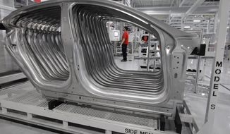 **FILE** Tesla Model S frames are shown June 22, 2012, in the assembly area at the Tesla factory in Fremont, Calif. (Associated Press)
