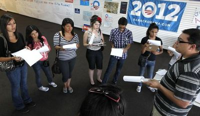 Brian Conklin, far right, a regional campaign director for the reelection of President Obama, briefs volunteers about registering new voters prior to them canvassing a heavily Latino neighborhood in Phoenix. Across the country both political parties have been courting the Latino vote, the nation's fastest-growing minority group. (AP Photo/Ross D. Franklin)