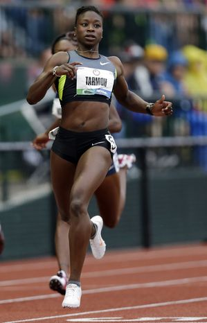 **FILE** Jeneba Tarmoh finishes first in her heat in the women's 200 meters at the U.S. Olympic track and field trials in Eugene, Ore., on June 28, 2012. (Associated Press)