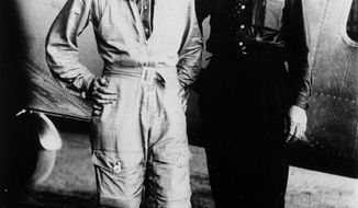 Amelia Earhart and navigator Fred Noonan stand by their Lockheed Electra before the start of Earhart's fateful 1937 attempt to become first female pilot to circle the globe. (Associated Press)