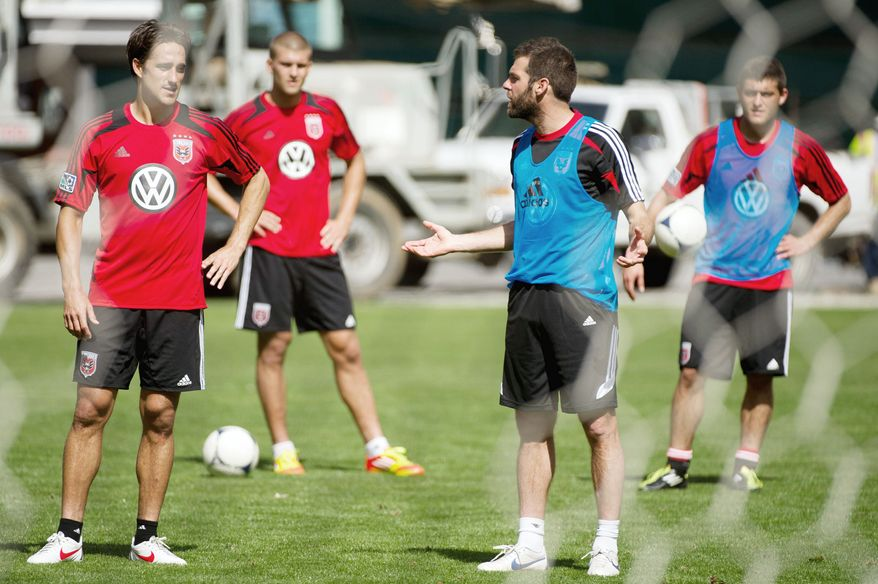 Forward Josh Wolff (left), shown with D.C United coach Ben Olsen (second from right) in March, has scored 80 goals in 265 games during his 14-year MLS career. (Andrew Harnik/The Washington Times)