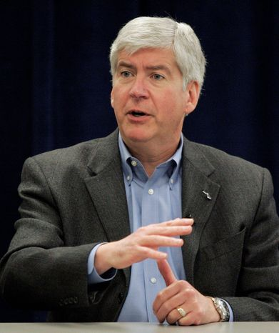 """Michigan Gov. Rick Snyder says some ballot efforts in November, particularly those by public sector unions, are """"a stifling of Michigan's reinvention."""" (Associated Press)"""