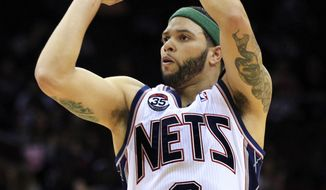"FILE - In this April 6, 2012, file photo, New Jersey Nets' Deron Williams (8) shoots during the first half of an NBA basketball game against the Washington Wizards in Newark, N.J. Williams said on his Twitter page, Tuesday, July 3, that he ""made a very tough decision today"" and posted a picture of the new team logo that accompanies the Nets' move from New Jersey to Brooklyn. A person with knowledge of the decision says Williams told the team Tuesday he was accepting their five-year contract worth $98 million. (AP Photo/Mel Evans, File)"