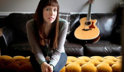 FILE - This April 5, 2011 file photo shows Christian musician Francesca Battistelli at her home in White, Ga. Battistelli and her husband, Matthew Goodwin, welcomed their second child, Audrey Jane Goodwin, at their Atlanta area home Tuesday, July 3, 2012. Her publicist said the baby weighs 8 pounds, 11 ounces and is 20 inches long. The couple have a son, Matthew Elijah, who was born in September 2010. (AP Photo/David Goldman, file)