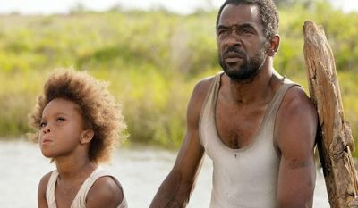 """Quvenzhane Wallis plays a motherless girl in a small bayou community in """"Beasts of the Southern Wild."""" Dwight Henry plays her father. Mr. Henry, who owns a bakery the filmmakers frequented in New Orleans, at first did not want to be in the film. (Associated Press)"""