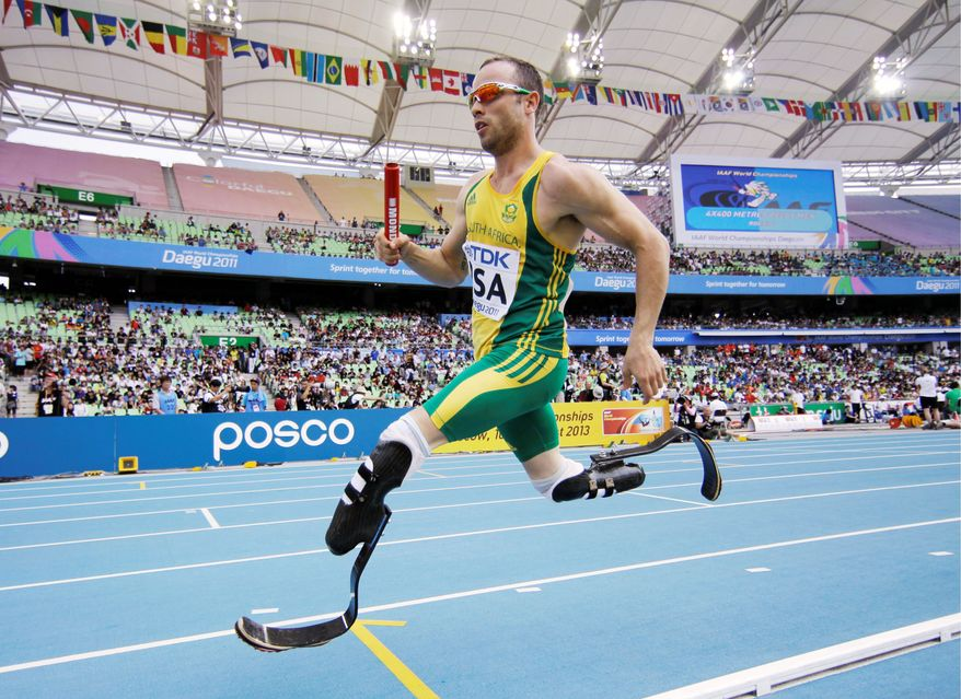 Oscar Pistorius of South Africa runs with the aid of carbon fiber blades. Both of his legs were amputated below the knee when he was 11 months old. (Associated Press)