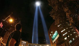 """Beams of light rise above Lower Manhattan to form the Tribute in Light memorial, which is featured in """"The City Dark."""" The documentary airs Thursday at 10 p.m. on PBS stations. (Associated Press)"""