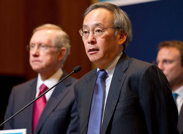Secretary of Energy Steven Chu (right) and Sen. Harry Reid, Nevada Democrat, announce construction of a hybrid geothermal/solar power plant in Nevada last summer. (Associated Press)