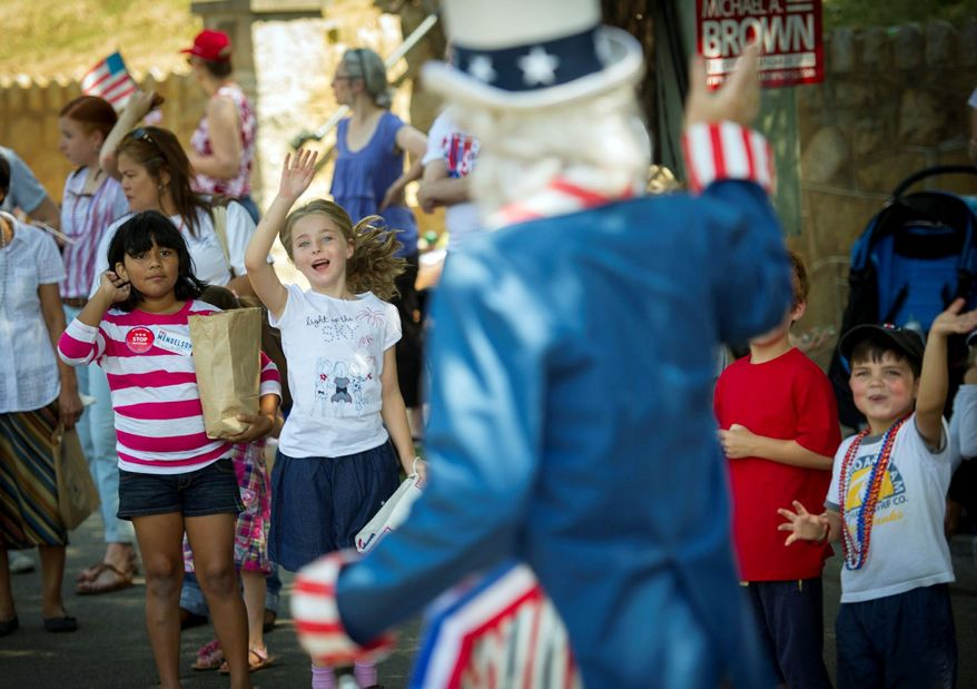 Children cheer as Grant Berning of Dunn Loring, dressed as Uncle Sam, marches past in the annual parade in the Palisades neighborhood of Northwest Washington. The parade is a big draw for local politicians. Story A16. (Rod Lamkey Jr./The Washington Times)