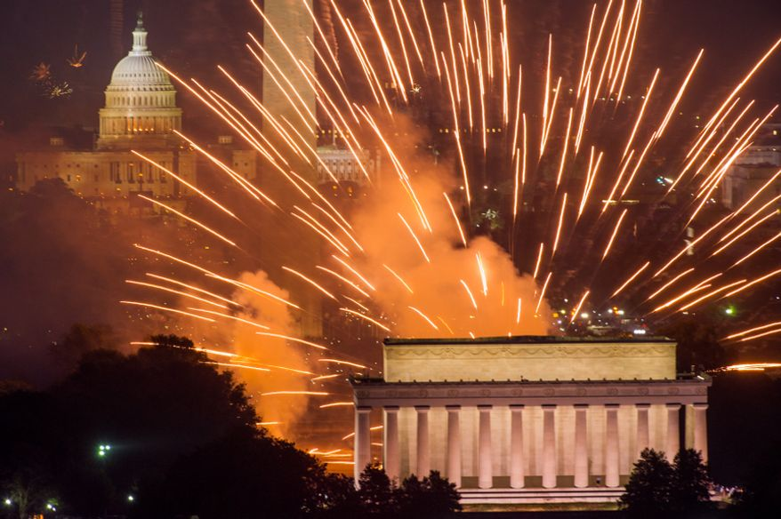 Fireworks can be seen from the Top of the Town in Arlington as they explode over the National Mall to celebrate Independence Day on Wednesday, July 4, 2012. (Andrew Harnik/The Washington Times)