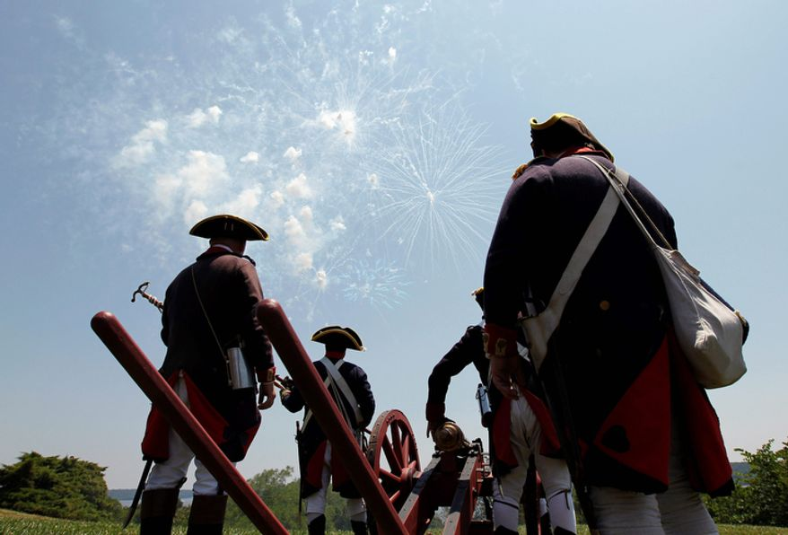 Re-enactors stand by their three-pound canon as they watch daytime fireworks during a Fourth of July event at George Washington's Mount Vernon in Alexandria, Va. (AP Photo/Alex Brandon)