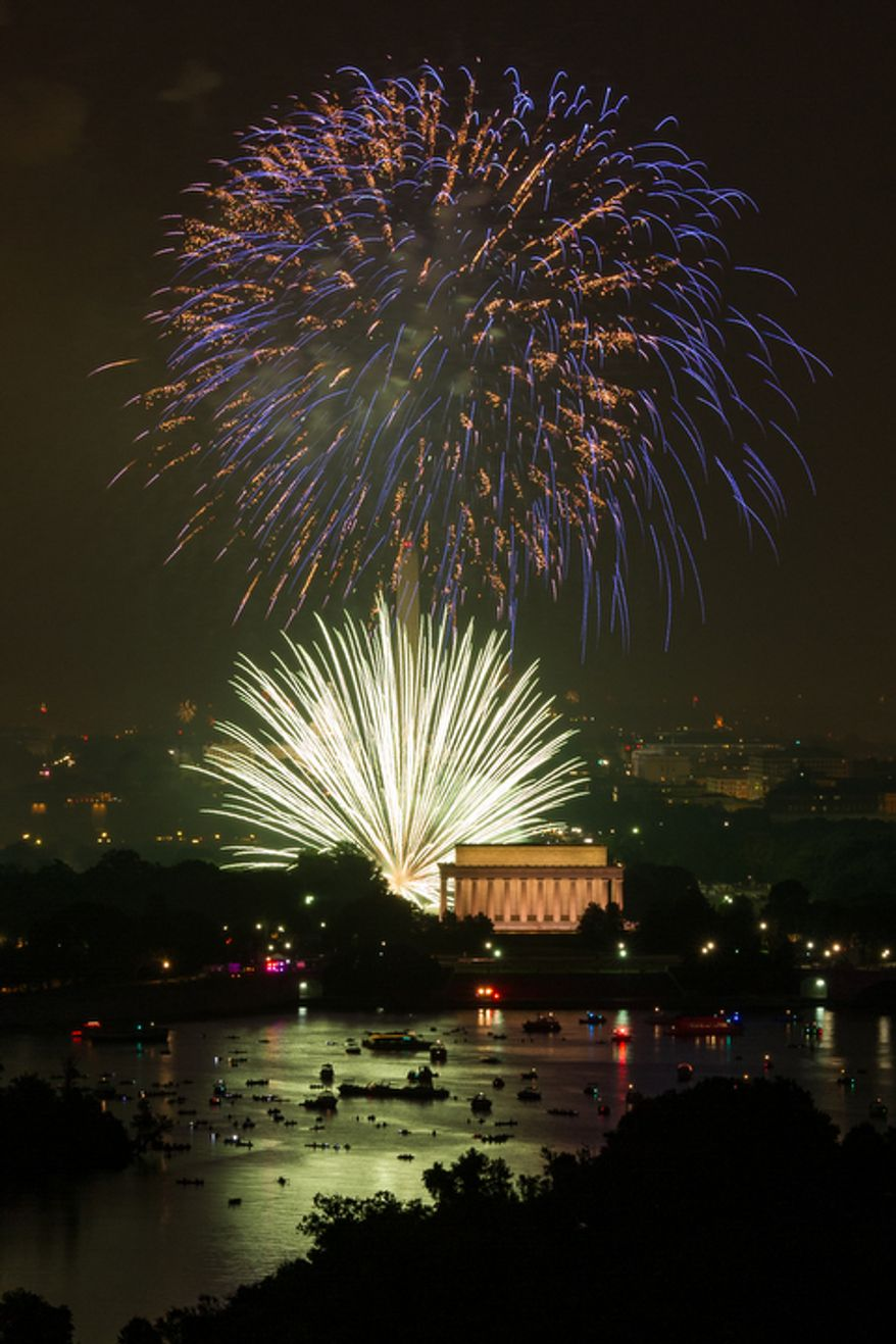 Fireworks can be seen from the Top of the Town as they explode over the National Mall to celebrate Independence Day. (Andrew Harnik/The Washington Times)