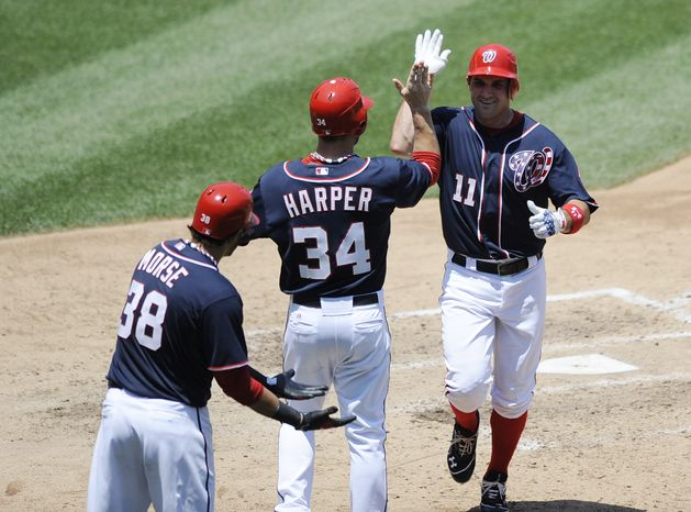 Washington Nationals' Ryan Zimmerman celebrates his two-run home run in the fifth inning against the San Francisco Giants on Wednesday, July 4, 2012, in Washington. The Nationals won 9-4. (AP Photo/Nick Wass)
