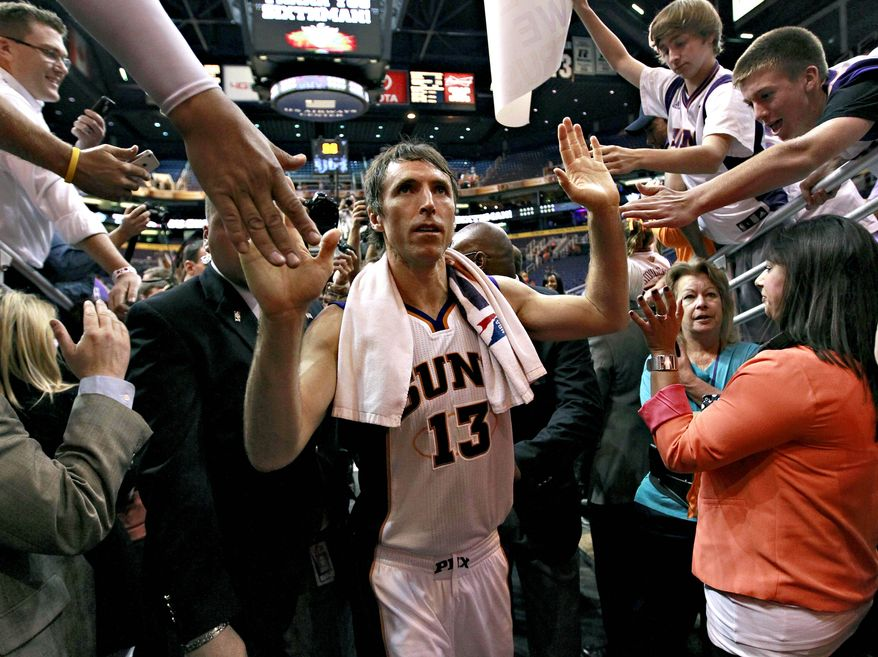 FILE - In this April 25, 2012, file photo, Phoenix Suns' Steve Nash leaves the court after an NBA basketball game against the San Antonio Spurs in Phoenix. Nash's agent Bill Duffy said Wednesday, July 4, that the two-time MVP point guard is going to the Los Angeles Lakers in a sign-and-trade deal with the Phoenix Suns. (AP Photo/Matt York, File)